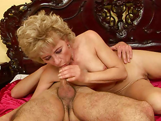 Mature whore gives her young lover a nice blowjob in 69 pose