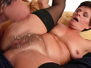 Dirty granny is getting huge cumshot on her hairy pussy