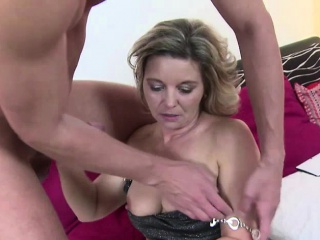 Blonde mature lady sucking off a young stud