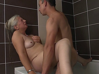 amateur 50+ woman rubs her pussy in bath and asks her toyboy to join her