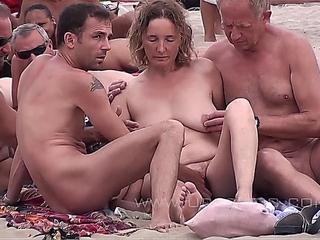 Couples Fuck On A Nude-Beach