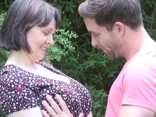 NastyPlace.org - Big tits mature with young boy in public place