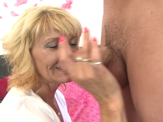 Mature blonde lady sucks and fucks young cock