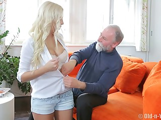 Experienced stud attacks the pretty blond with his erected wang