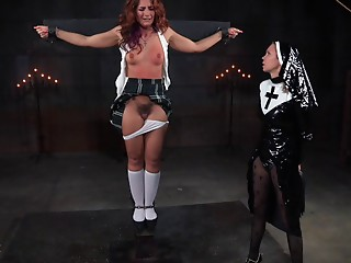 This old redhead has been very nasty and the nun will castigate her!