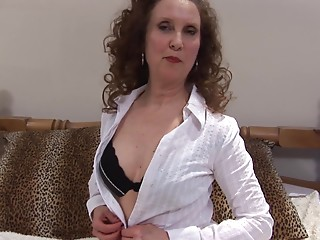 Curly-haired old slut with a smutty mind using the realistic fake penis