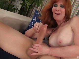 Old redhead minx Freya enjoys being slammed with a bulky dick