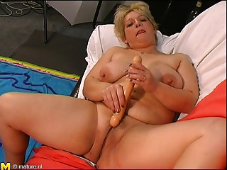 Lusty old BBW is madly in love with a lengthy dildo