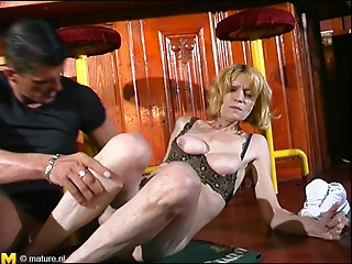 Saucy golden-haired old slut sucks on a thick member and receives screwed