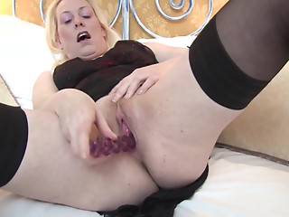 Buxom matured golden-haired posing fascinating whilst screwing her vagina using toy