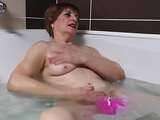 Handsome matured grandmother fingering her cunt immensely in the washroom tab