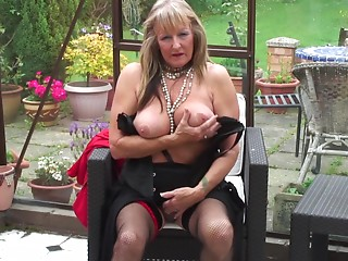 Brilliant matured grandmother stripteasing in advance of masturbating outdoor