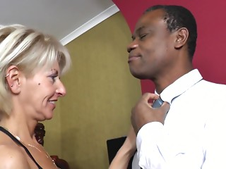 Fully erected ebony ramrod for the taut slit of an experienced lady