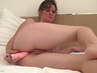 Bulky solo model delights fingering her wet crack then shoves a lengthy vibrator down her backdoor