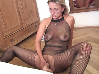 Solo model in fishnet hose sits her vagina against a giant vibrator in her lonely apartment