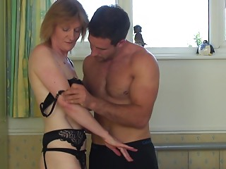Middle-aged maid lets the brawny stud take her from the behind