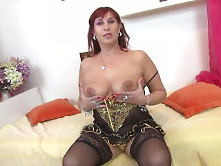 Middle-aged babe with the red hair enjoys her time with the dong