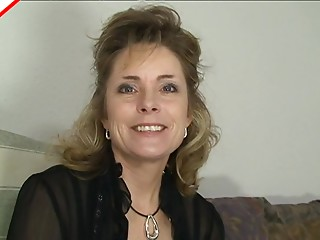 Gorgeous older whore in a darksome blouse sucks weenie sensually