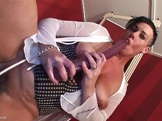 Thick elder broad in darksome leather boots acquires screwed
