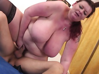 Aged BBW redhead acquires him hard with her throat and rides him