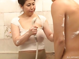 Overweight Japanese gal sucks her partner's dong in the baths