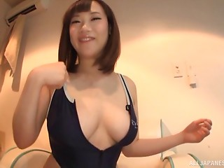 Wonderfully curvaceous Japanese mommy plays with a sex-toy