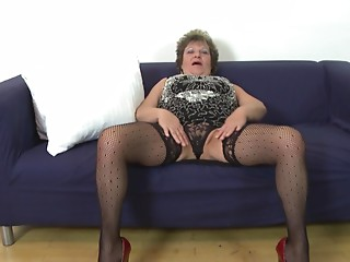 Large stomach and saggy breasts on this solo masturbating older sweetheart