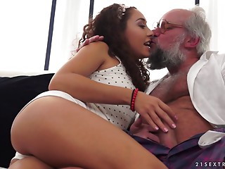 Hypnotic unshaved babe riding the ramrod of the experienced dude