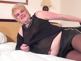 Lewd blond MILF with big milk sacks is having the solo session