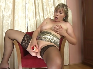 Sexy mama takes off her satin pants and copulates her sex toy