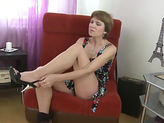 Charming older hottie with short hair and natural zeppelins bonks a toy