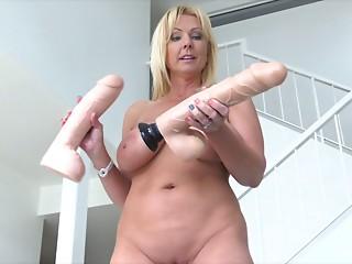 Mommy with gigantic dildos bonks 'em into her moist wet crack