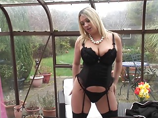 Chic and curvy cougar stripping and showing off her underware