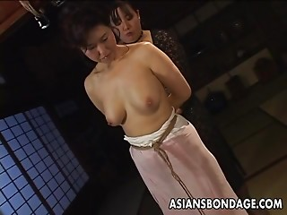 Older slut receives roped up and hung in a sadomasochism session