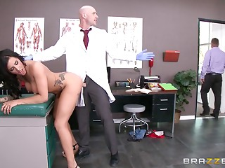 Tattooed brunette hair patient with large milk cans bonks in the hospital