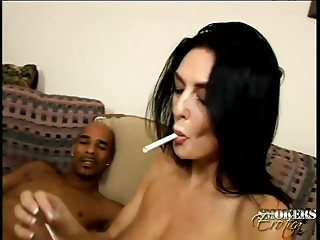 His ebony schlong is so large it takes 2 hands for her to jerk him off
