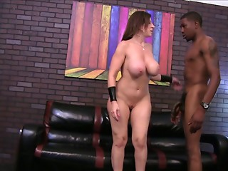 A cuckolded spouse watches his wife ride a huge ebony meat