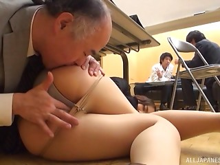 Mature Oriental dude climbs underneath the desk to eat secretary booty