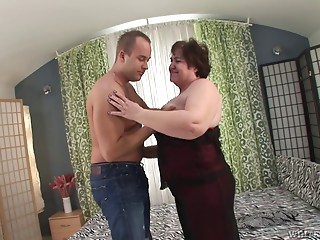 Aged BBW jiggles as his schlong nails her slippery pussy