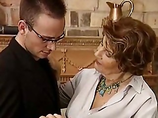 Smutty Granny Sucks and Fucks a Young Stud's Cock With Delight