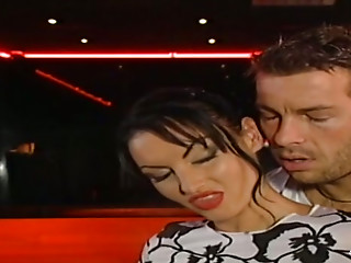 Sexy brunette girl gives hot blowjob in the club