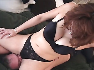 Horny busty brunette MILF in black lingerie makes dude sniff her holes